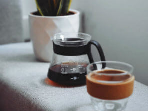 A plant, a pot of coffee and a lidless KeepCup on a table : Organico Blog