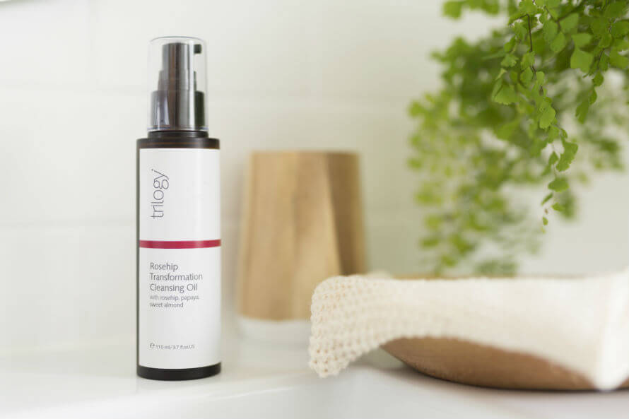 Trilogy Rosehip Transformation Cleansing Oil on a bathroom counter