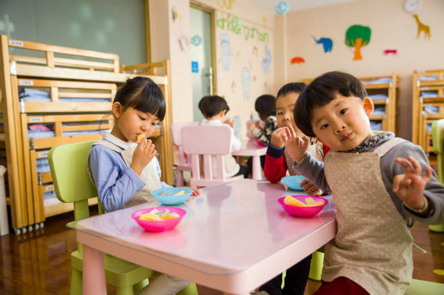Children having lunch in a classroom