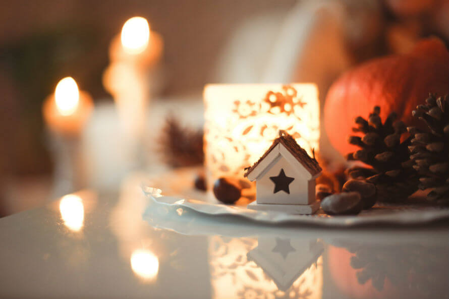Christmas decorations including pine cones, pumpkin and candles