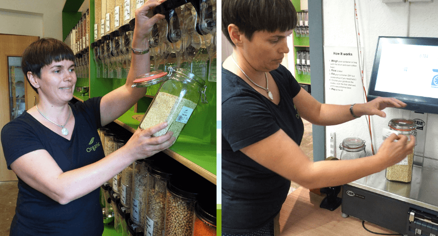 Hannah from Organico filling and weighing a reusable glass jar zero-waste shopping area