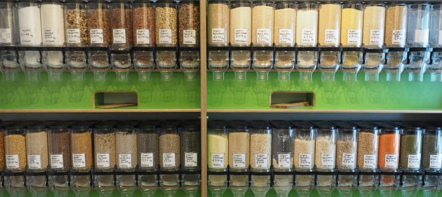 A row of dispensers filled with dried foods in Organico's zero-waste shopping refill area