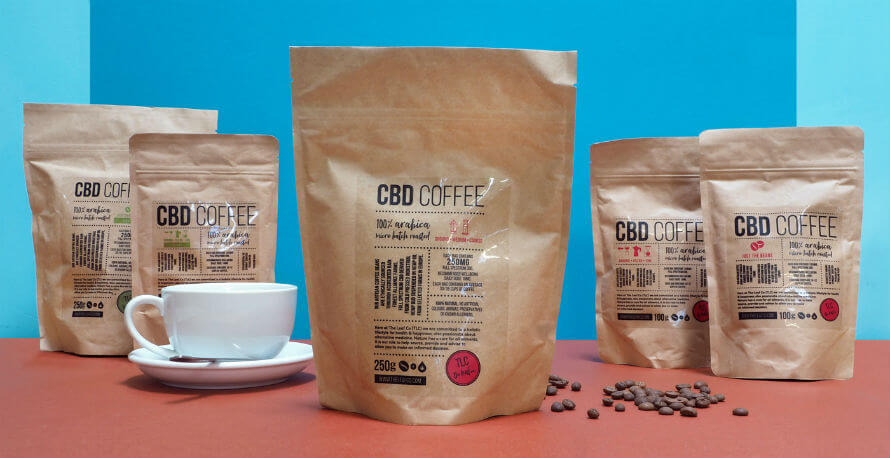 Bags of CBD coffee and a cup and saucer
