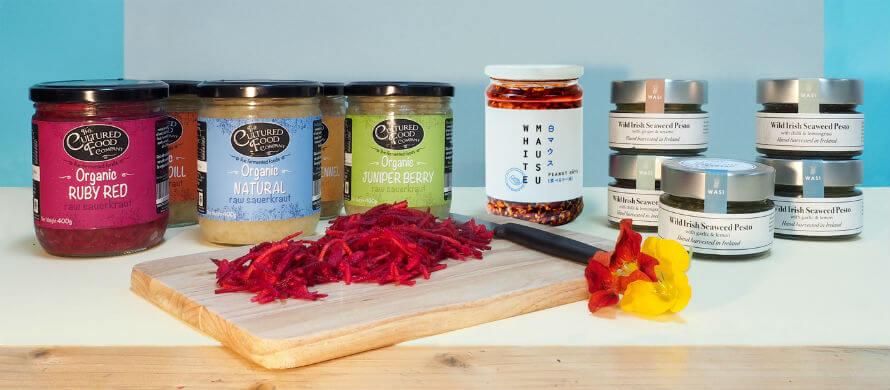 Jars of The Cultured Food Company kraut, White Mausu Peanut Rayu, and WASi Seaweeds pesto