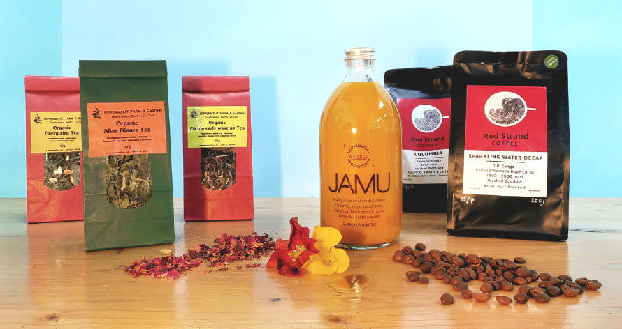 Bags of Red Strand Coffee and Peppermint Farm Tea and a bottle of MuTonics JAMU