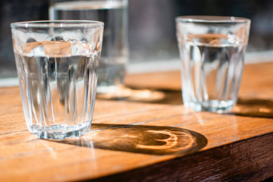 Three glasses of water on a table