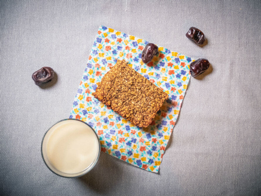 Sugar-free vegan flapjack with glass of milk and scattered dates