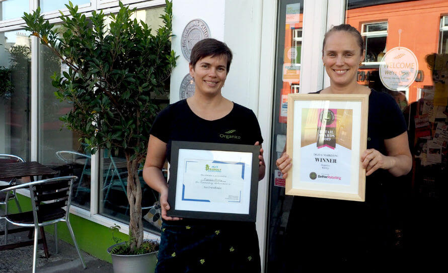 Hannah and Rachel Dare standing outside their business, Organico, with their recent awards