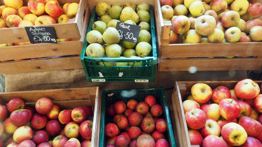 Crates of apples from fresh produce section inside Organico Shop