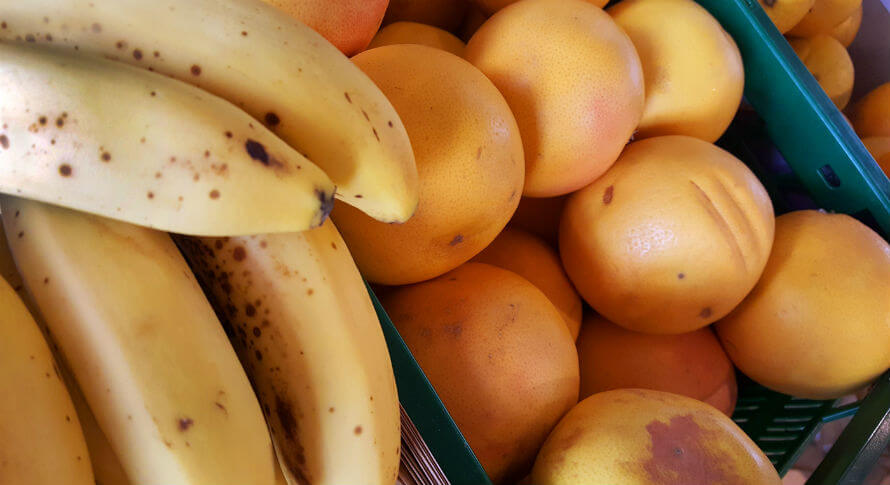 Bananas and grapefruit from fresh produce section in Organico Shop