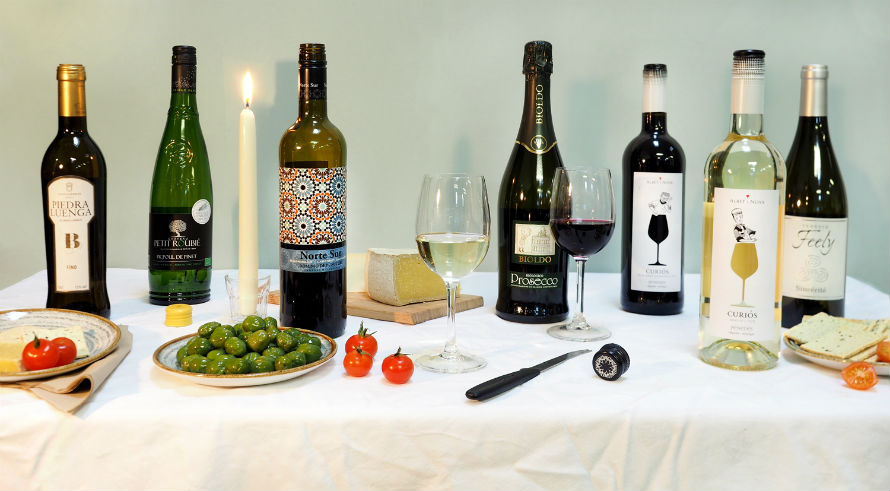 Bottles of wine and food on the table