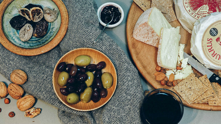 Cheeseboard and glass of organic wine