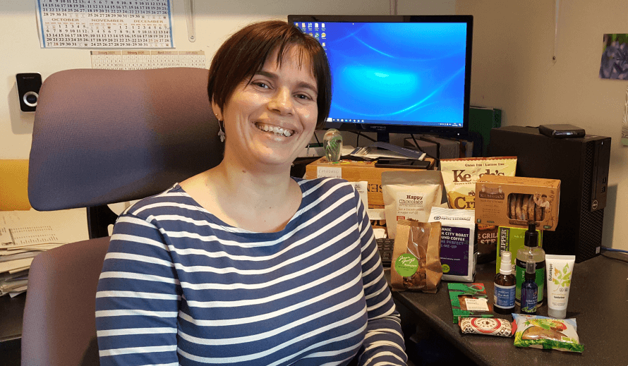 Hannah Dare of Organico in her office with a the working from home pack